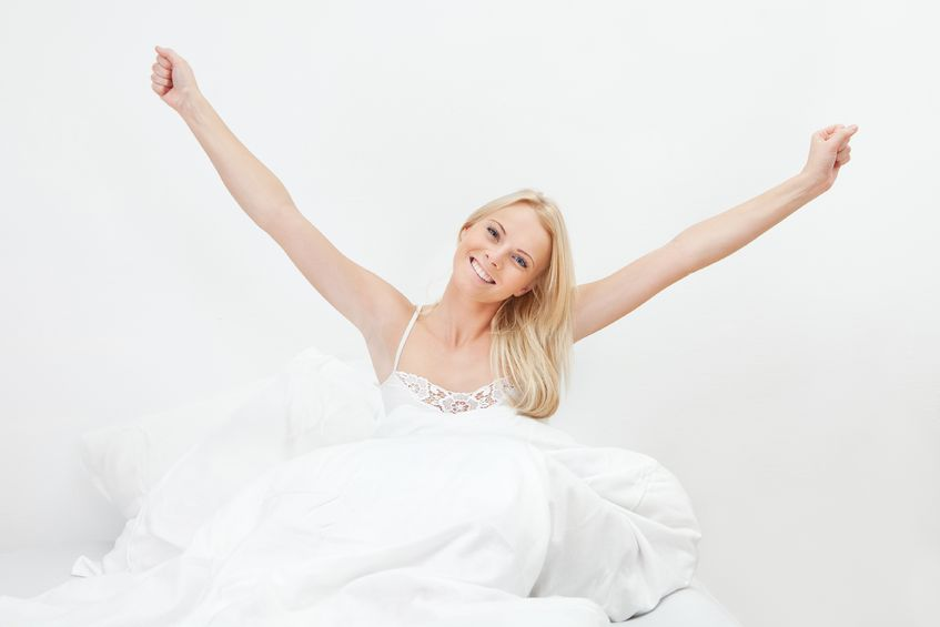 12475390 - young happy smiling woman waking up