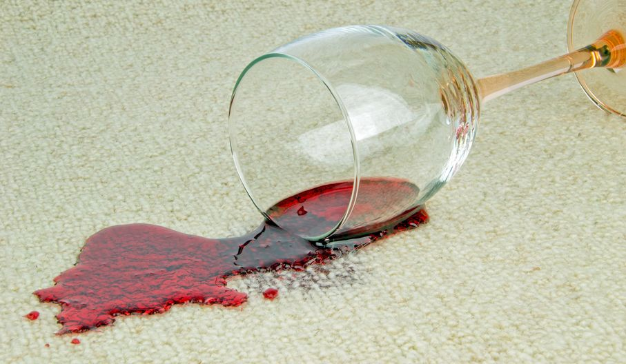 21677053 - a spilled glass of red wine on a carpet