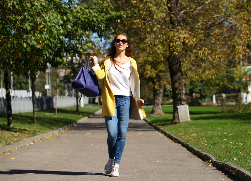 36585378 - beautiful woman in yellow coat walking autumn street