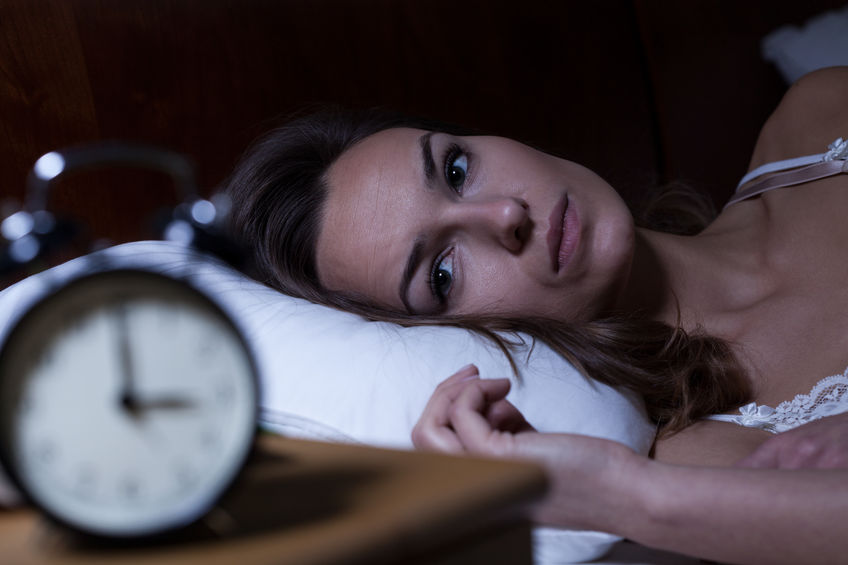 32559585 - woman lying in bed suffering from insomnia