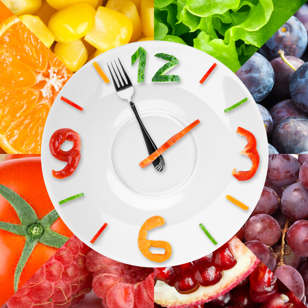 44704936 - food clock with vegetables and fruits as background. healthy food concept