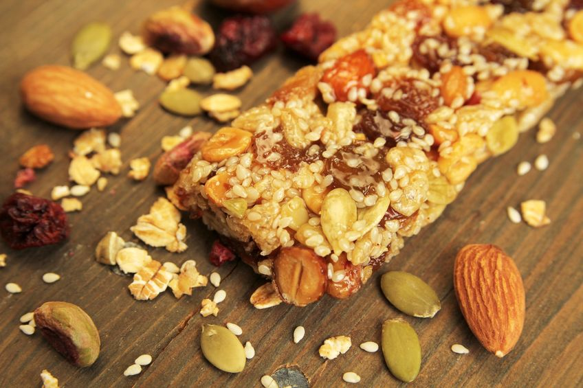 14626465 - organic granola bar with nuts and dry fruits on a wooden table