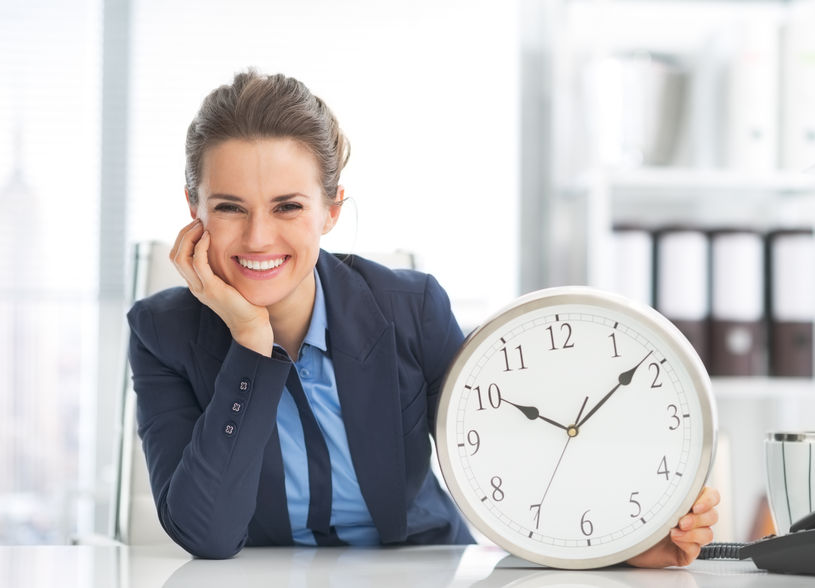 27035886 - happy business woman showing clock