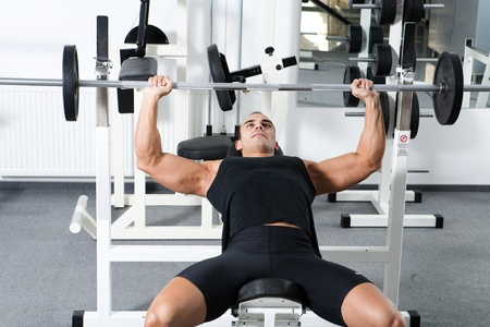 12859834 - young bodybuilder training in the gym: chest - barbell incline bench press - wide grip
